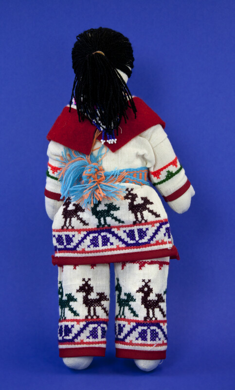 Alaska Indian with Beads and Symbols (Back View)