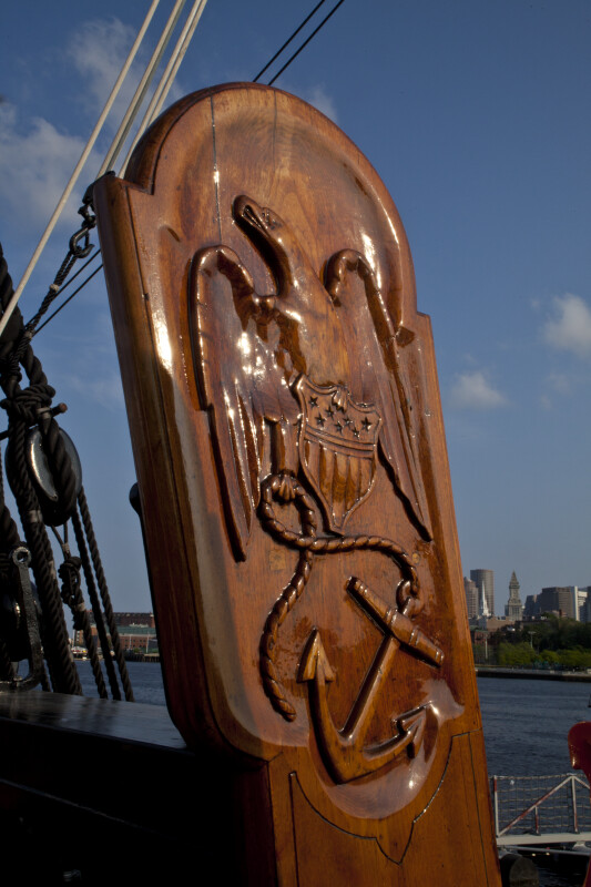 An Eagle and Anchor Carved on a Piece of Wood