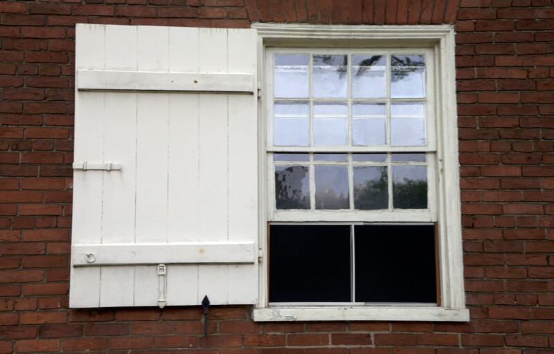 An Eight-Over-Twelve Sash Window with a Shutter