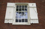 An Eight-Over-Twelve Sash Window with Shutters