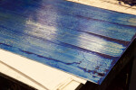 An etching plate with blue ink ready for wiping.