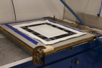 An etching print sitting on a screenprinting vaccum table.