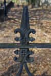 An Even Closer View of a Metal Fence around a Cemetery Plot