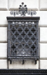 An Iron Grille over a Window