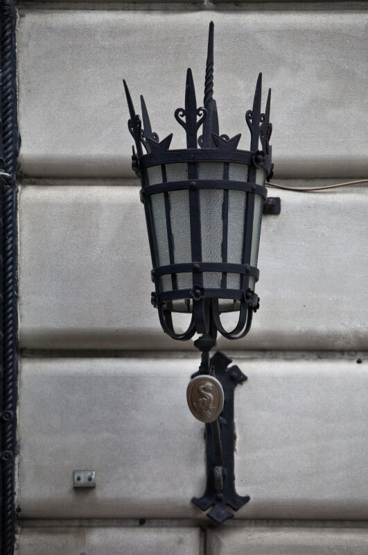 An Lamp with a Wrought Iron Sconce