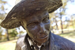 An Oblique Close-Up of the Face of a Bronze Sculpture Depicting a Farmer