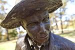 An Oblique Close-Up of the Face of a Bronze Sculpture Depicting a Farmer