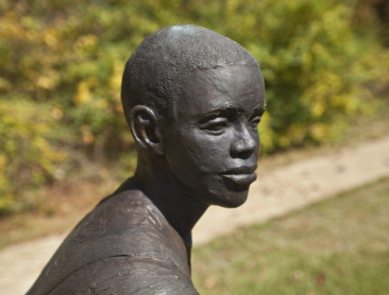 An Oblique View of the Face of a Bronze Figure Depicting a Young Boy at Corinth Contraband Camp