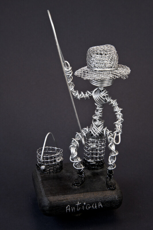 Antigua Fisherman Handcrafted from Wire on Dark Background (Full View)