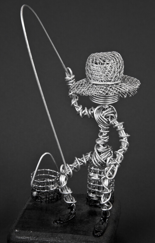 Antigua Hand Made Wire Fisherman Holding a Fishing Pole (Three Quarter View)