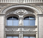 Arched Top Windows and Decorative Horizontal Spandrel Panels
