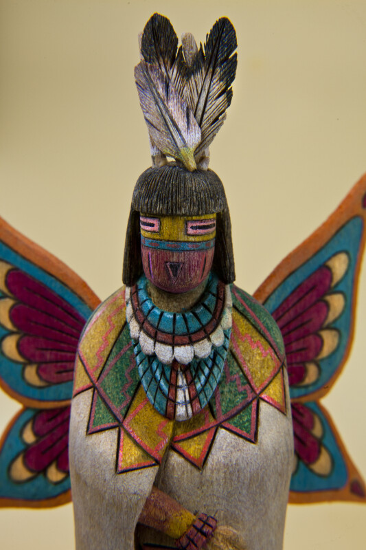 Arizona Details of Hopi Kachina Figure Showing Colorful Carved Necklace, Jewelry, Face, and Wings (Close Up)