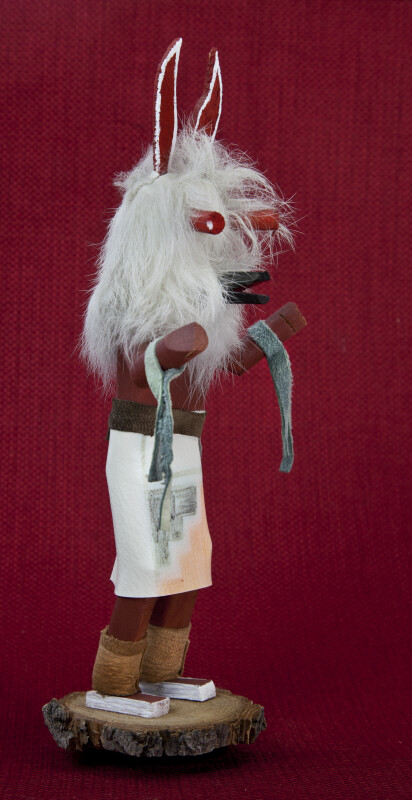 Arizona Kachina Doll with Wooden Wolf Ears, Wood Eyes, and Wood Mouth Wearing a Leather Skirt  (Profile View)