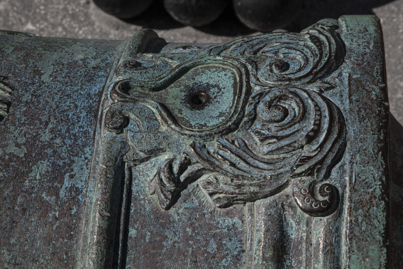 Artistic Carvings on a Bronze, Oxidized Cannon