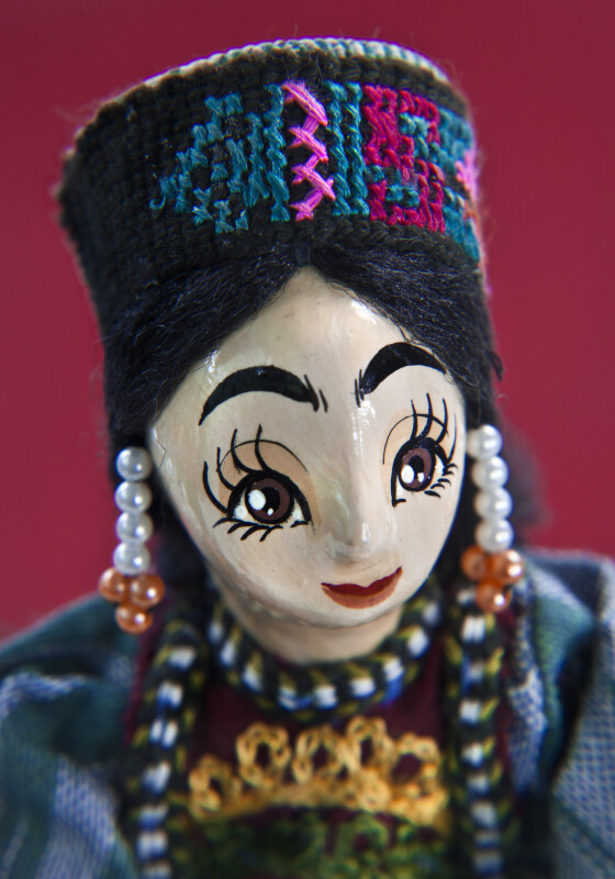 Azerbaijan Woman with Hand Painted Wood Face and Beaded Earrings (Close Up)
