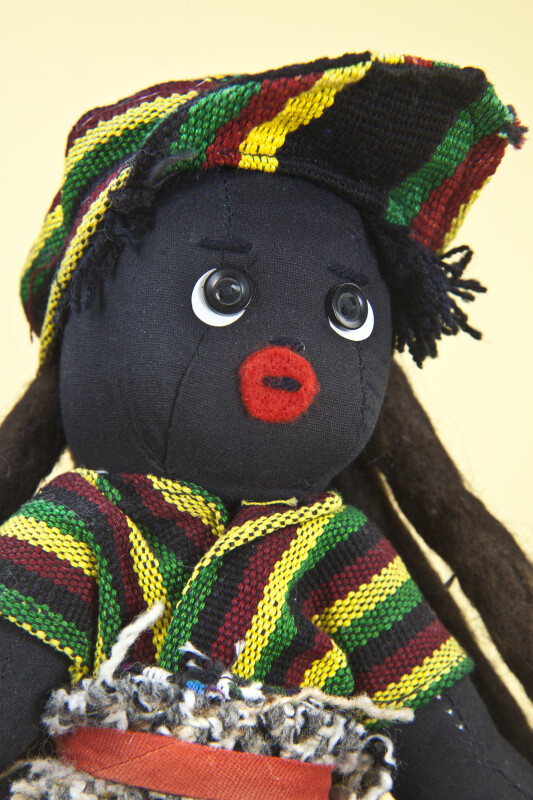 Bahamas Hand Made Figure of Man with Dreadlocks. Along with Buttons for Eyes, and Felt for His Mouth (Close Up)