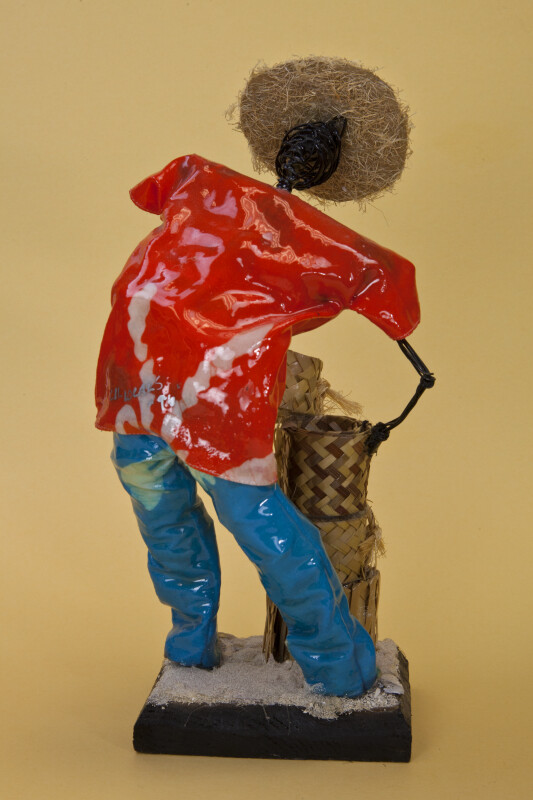 Bahamas Hand Made Wire Sculpture of Man Who is Stacking Straw Baskets (Back View)