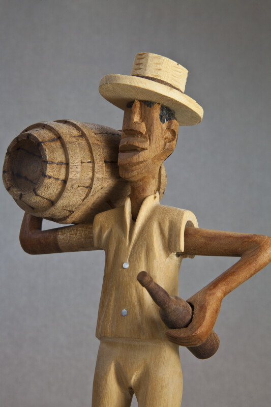 Bahamas Male Figure Carved from Wood and Wearing a Hat (Three Quarter View)
