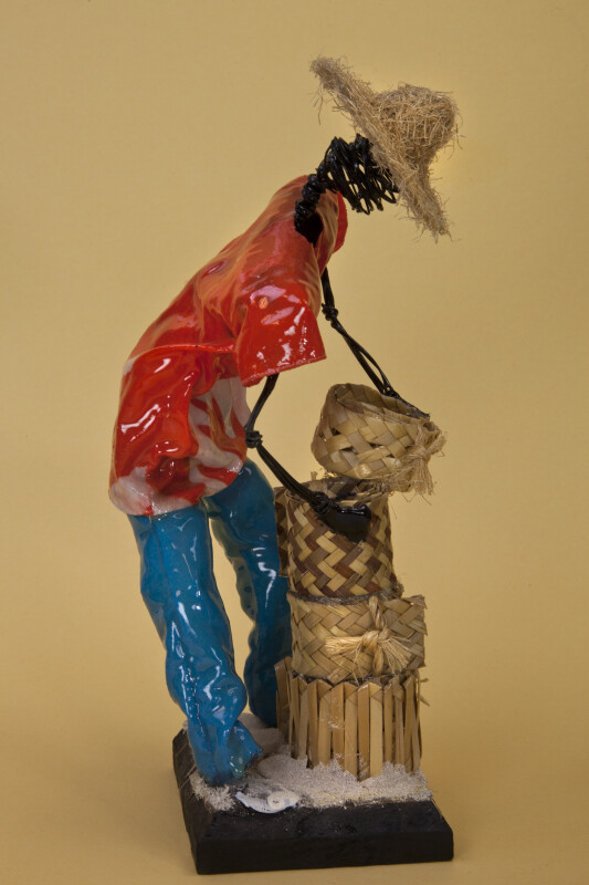 Bahamas Male Sculpture Made with Wire and Wearing a Straw Hat (Profile View)
