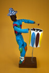 Barbados - Male Playing Steel Drum (Side View)