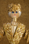 Belarus Female Doll Made of Wheat with Hand Painted Facial Features on Wood (Close Up)