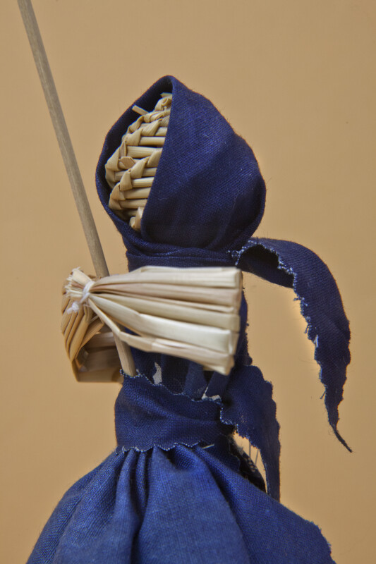 Belarus Female Figurine Made Completely from Straw Wearing a Cotton Skirt, Apron, and Scarf (Profile View)
