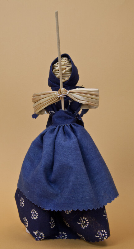 Belarus Handcrafted  Straw Doll  with Face Made of Woven Straw Holding a Straw Broom (Full View)