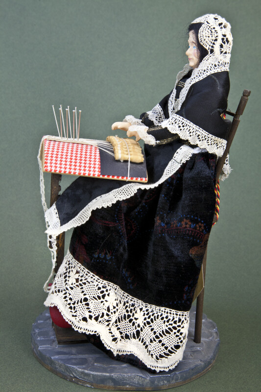 Belgium Handcrafted Female Lace Maker Doll Sitting in Wooden Chair (Side View)