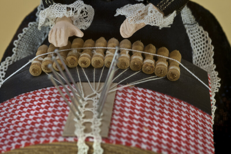 Belgium Traditional Technique for Making Lace with Bobbins, Pillow, Pins, and Thread (Close Up of Lacing View)