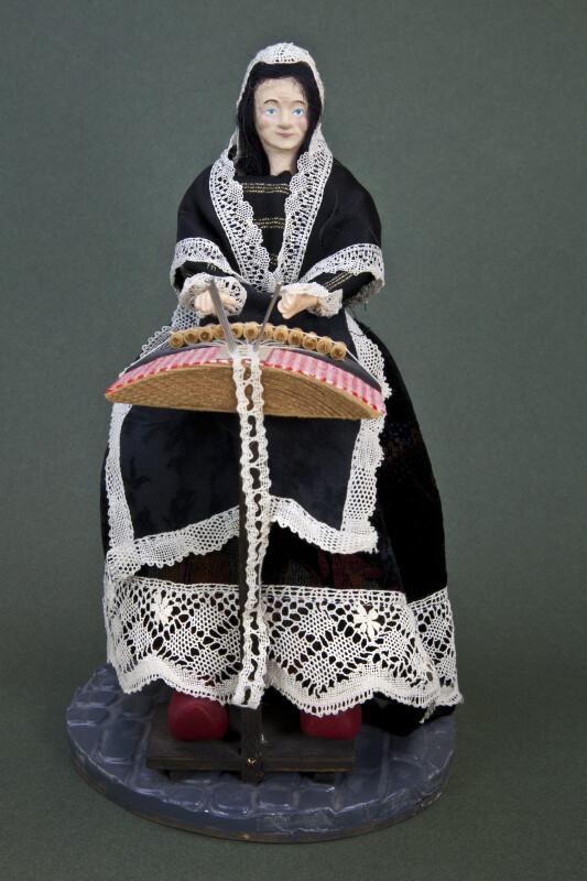 Belgium Unique Design of Lady Doll Making Lace in Bruges Belgium (Full View Dark Background)