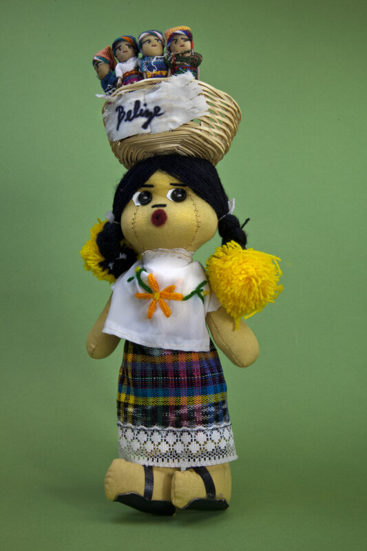 Belize Female Doll Made from Stuffed Cloth, Yarn Buttons, Lace, and Leather (Full View)