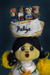 Belize Handcrafted Girl with Straw Basket and Worry Dolls (Close Up Light Background)