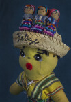 Belize Male with Straw Basket and Worry Dolls on His Head (Close Up Dark Background)