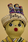 Belize Young Man Handcrafted from Cloth, Straw, Felt and Buttons  (Close Up Light Background)