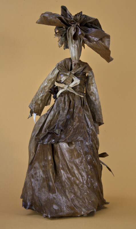 Bermuda Female Figure Made from Banana Leaves and Dried Flowers (Back View)