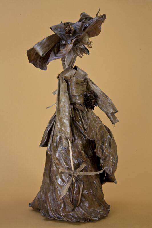 Bermuda Female Doll Made from Banana Leaves, Seeds, and Dried Flowers (Three Quarter View)
