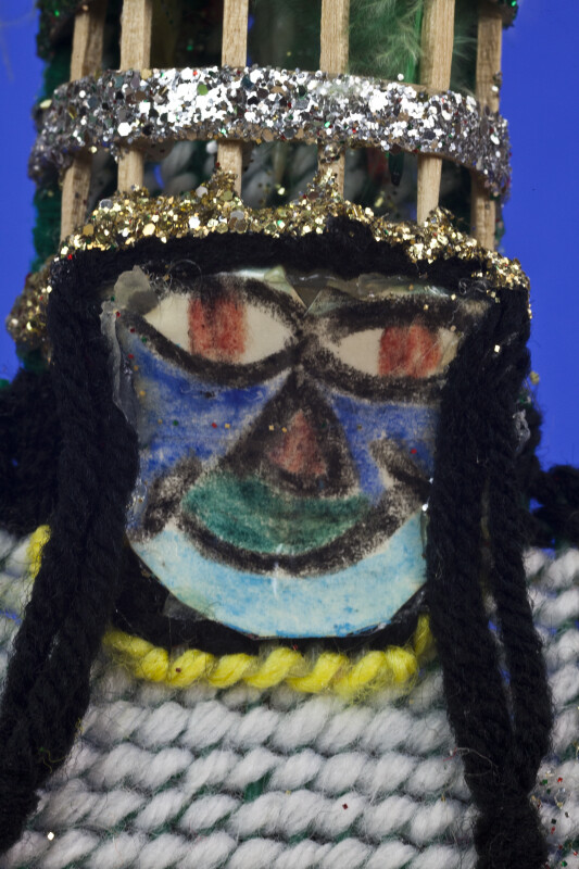 Bermuda Male Gombey Dancer with Traditional Painted Mask, and Headdress with Feathers (Close Up)