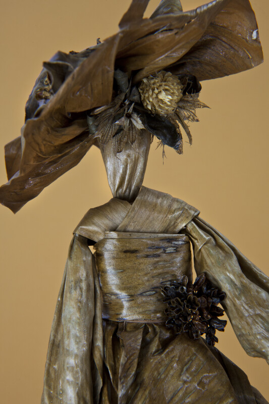 Bermuda Woman Made from Banana Leaves Wearing a Large Fancy Hat (Close Up)