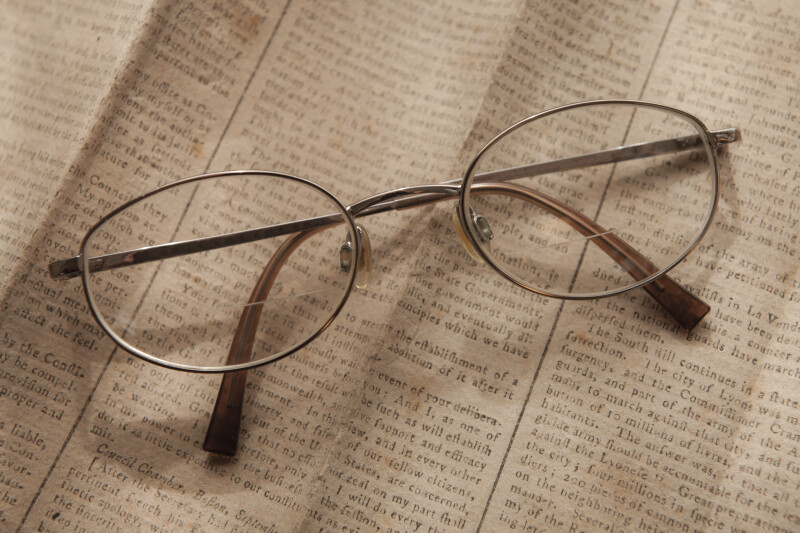 Bi-focal Glasses on Newspaper