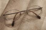 Bi-focal Glasses on Newspaper