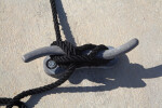 Black Rope Tied to a Wavy Dock Cleat