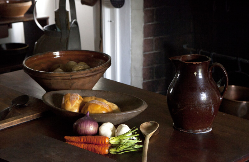 Bowls Filled with Food, and a Redware Pitcher with Brown Glaze