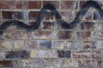 Brick Wall in City Alley