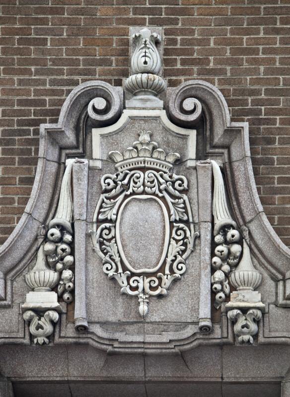 Brickwork behind a Cartouche