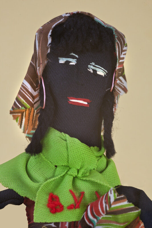 British Virgin Islands Doll with Embroidered Facial Features, Black Yarn Hair and Head Scarf (Close Up)