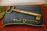 Bronze Kaaba Key on a Blue Pillow