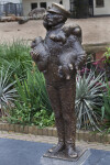 Bronze Statue of Man Carrying Several Small Animals