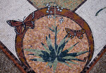 Butterflies and a Flowering Plant in a Mosaic