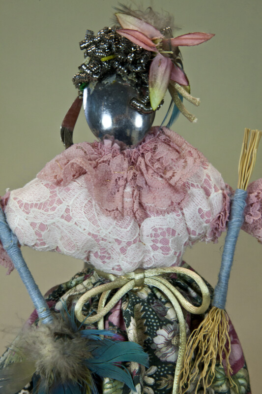California Kitchen Utensil Doll Holding Feather Duster with Wire Brush for Hair (Close Up)