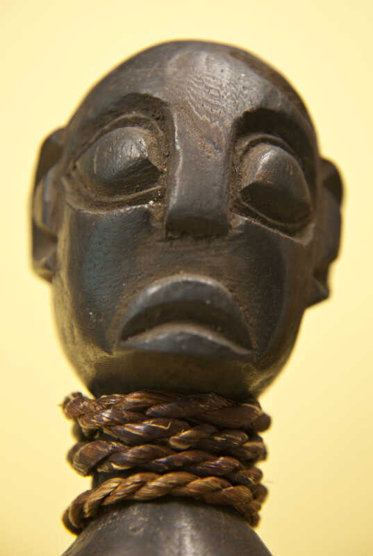 Cameroon Handcrafted Wood Carving of Man with Rope Wrapped Around Neck (Close Up)